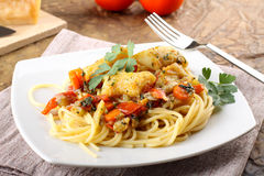 Pasta with fresh grouper fillet. On complex background Royalty Free Stock Images