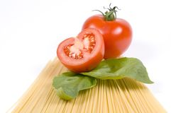 Pasta and fresh ingredients. Pasta and fresh tomatoes and basil royalty free stock images