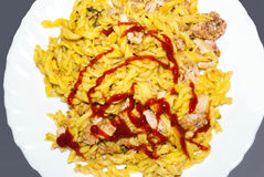 Pasta with fresh meat and ketchup topping Stock Images