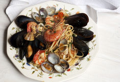 Pasta with fresh mollusk Stock Images
