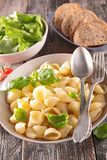 Pasta, fresh salad and bread Royalty Free Stock Images