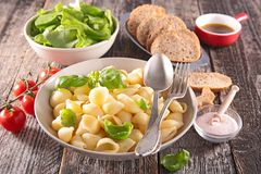 Pasta, fresh salad and bread Stock Photos