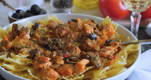 Pasta with fresh salmon and black olives Royalty Free Stock Images