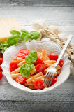 Pasta with fresh tomatoes Royalty Free Stock Photo