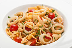 Pasta with fresh tomatoes and basil. Stock Image