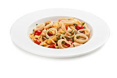Pasta with fresh tomatoes and basil. Stock Photography