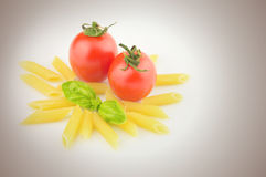 Pasta, fresh tomatoes and basil Royalty Free Stock Images