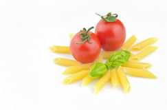 Pasta, fresh tomatoes and basil with copyspace Stock Photo