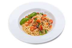 Pasta with fresh tomatoes and basil. Royalty Free Stock Photo