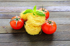 Pasta and fresh tomatoes Royalty Free Stock Image