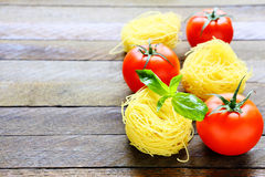 Pasta and fresh tomatoes Royalty Free Stock Photo