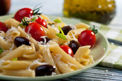 Pasta with fresh tomatoes and olives Stock Image