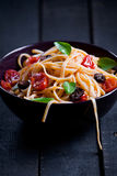 Pasta With Fresh Tomatoes And Olives. Close up of some pasta with tomatoes olives and basil royalty free stock photos