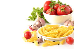 Pasta, fresh tomatoes and spices Royalty Free Stock Photos