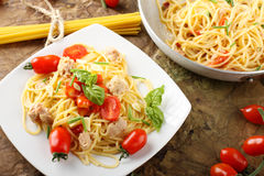 Pasta with fresh tomatoes, tuna and basil Stock Image