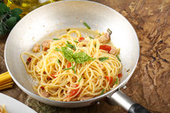 Pasta with fresh tomatoes, tuna and basil Stock Photo