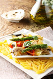Pasta with fresh tuna, mushrooms and asparagus Stock Photography