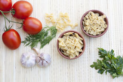 Pasta with fresh vegetables and herbs. On makisu royalty free stock photography