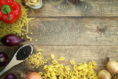 Pasta with fresh vegetables on the table Stock Image
