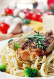 Pasta with fried chicken Royalty Free Stock Images
