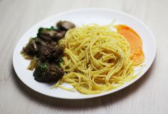 Pasta with fried liver and spacy sauce stock photography