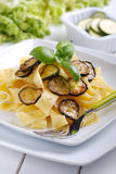 Pasta with fried zucchini Royalty Free Stock Images