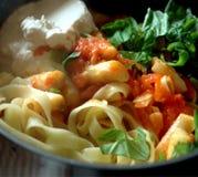 Pasta on frying pan stock photos