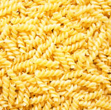 Pasta fusili as background Royalty Free Stock Images