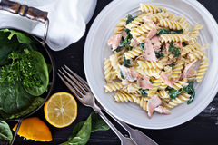 Pasta fusilli with baked salmon and spinach Stock Image