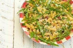 Pasta Fusilli with Fresh Garlic and Rocket Leaves, Spanish Chori Stock Image