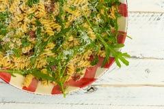 Pasta Fusilli with Fresh Garlic and Rocket Leaves, Spanish Chori Stock Photos