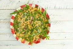Pasta Fusilli with Fresh Garlic and Rocket Leaves, Spanish Chori Stock Photography