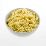 Pasta fusilli in plate isolated on white background Royalty Free Stock Photography