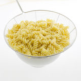 Pasta fusilli in plate isolated on white background Stock Photo