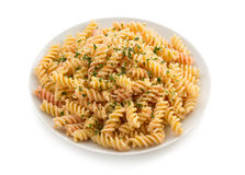Pasta fusilli in plate on white Royalty Free Stock Images