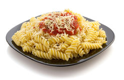 Pasta fusilli in plate on white Royalty Free Stock Image