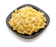 Pasta fusilli in plate on white Stock Images