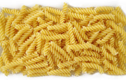 Pasta fusilli. Raw pasta fusilli texture background Royalty Free Stock Images