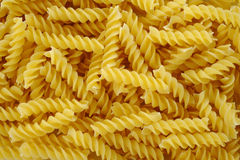 Pasta fusilli texture background Stock Photography