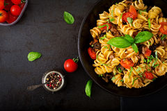Pasta Fusilli with tomatoes, beef and basil Stock Images