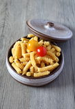 Pasta fusilli and two cherry tomatoes Stock Image