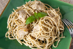 Pasta with Garlic Chicken and Pesto Sauce Stock Image