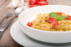 Pasta With Garlic and Tomatoes Stock Photos