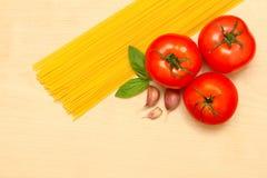 Pasta, garlic, tomatoes and basil Stock Photo