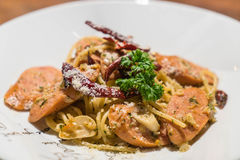 Pasta with germany sausage. Stir-fried pasta with germany sausage Stock Photos
