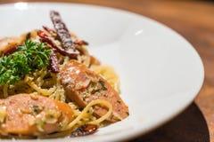 Pasta with germany sausage. Stir-fried pasta with germany sausage Stock Photography