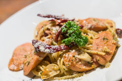 Pasta with germany sausage. Stir-fried pasta with germany sausage Stock Photo