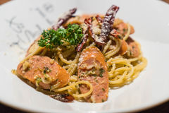 Pasta with germany sausage. Stir-fried pasta with germany sausage Royalty Free Stock Images