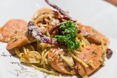 Pasta with germany sausage. Stir-fried pasta with germany sausage Stock Image