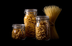 Pasta. In glass jar on a black background Royalty Free Stock Photography
